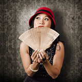 Chinese girl fanning herself with Asian hand fan Royalty Free Stock Photography