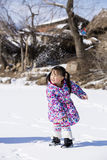 The Chinese girl fights. Snowball fights in the snow China woman stock photos