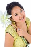 Chinese girl with flower. Portrait of Chinese female with flower Royalty Free Stock Photography