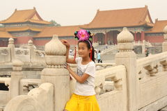 Chinese girl in Forbidden City Stock Photos