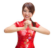 Chinese girl greeting. Chinese girl in traditional Chinese cheongsam greeting, isolated on white background Royalty Free Stock Photos