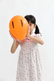 Chinese girl hide behind a balloon Royalty Free Stock Images