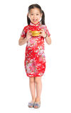 Chinese girl holding a gold ingot. Full length China girl in traditional Chinese cheongsam dress greeting, holding a gold ingot standing isolated on white royalty free stock images
