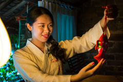 Chinese girl holding good luck symbol. Wearing traditional clothes stock photography