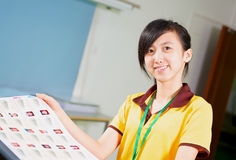 Chinese girl holding a proofing in printing house. Happy Asian girl holding a proofing in printing house Royalty Free Stock Images