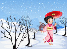 A chinese girl holding an umbrella walking outside with snow Royalty Free Stock Image