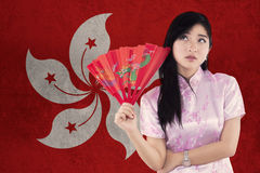 Chinese girl holds a fan with Hongkong flag Royalty Free Stock Photo