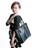 Chinese girl Kua shoulder bag Stock Image