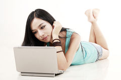 Chinese girl with laptop Stock Images