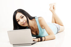 Chinese girl with laptop Royalty Free Stock Photography