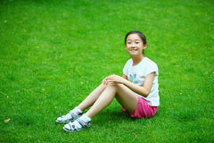 Chinese girl on the lawn Stock Image