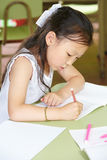 Chinese girl learning to write Stock Image