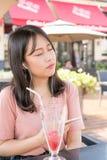 Chinese girl listening music stock image