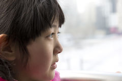 Chinese girl Look from afar. Chinese girl in the railway station Royalty Free Stock Image