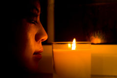 Chinese girl looking at a candle. Stock Photography