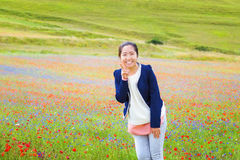 Chinese girl in the middle of the field of multi-colored flowers Stock Photography