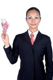 Chinese girl with money. Chinese businesswoman wearing black suit, red tie, elegant looks, kind face expression, holding Chinese RMB banknotes Royalty Free Stock Images