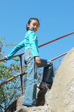Chinese girl in mountain climbing Stock Images