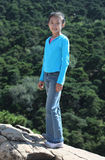 Chinese girl in mountain climbing Royalty Free Stock Photo