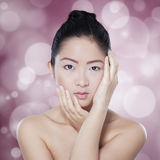 Chinese girl with natural skin in studio Stock Photo