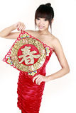 Chinese girl in new year. Chinese girl holding a new year's painting on white Royalty Free Stock Photos