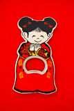 Chinese girl opener. Chinese girl cap opener on red background Stock Images