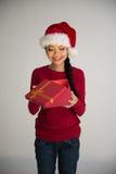 Chinese girl opening christmas Royalty Free Stock Photo