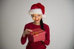 Chinese girl opening christmas gift Stock Photo