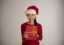 Chinese girl opening christmas gift Stock Images