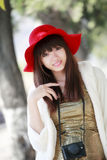 Chinese girl outdoor portrait. Chinese girl with red hat outdoor portrait Royalty Free Stock Image