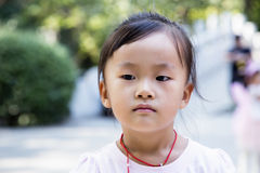 Chinese girl in the park. Chinese female in the Holiday Park Stock Photography