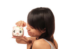 Chinese girl with piggy bank Stock Photo