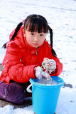 Chinese girl playing in snow Royalty Free Stock Photo