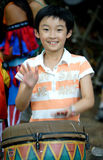 Chinese girl plays drum. The chinese girl plays musical instrument Royalty Free Stock Images
