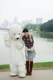 Chinese girl and polar bear mascot Royalty Free Stock Photography