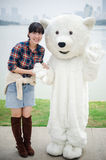 Chinese girl and polar bear mascot Stock Photography