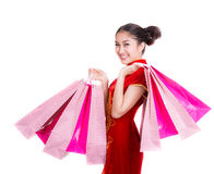 Chinese girl with qipao and shopping bag Royalty Free Stock Photos