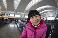 Chinese girl in the railway station.  Royalty Free Stock Photography