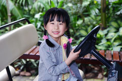Chinese girl in the rainforest. Chinese girl in the car ,in the rainforest,sanya.china Stock Photography
