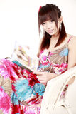 Chinese girl reading magazine. Royalty Free Stock Photography