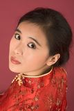 Chinese girl in red cheongsam Stock Images
