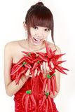 Chinese girl with red pepper. Cute Chinese girl holding a bunch of red pepper decorations on white. Red pepper in the Chinese culture symbolize a good life stock illustration