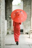 Chinese girl and red umbrella Royalty Free Stock Image