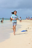 Chinese girl running on beach royalty free stock image