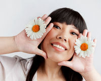 Chinese girl with Russian camomiles Stock Image