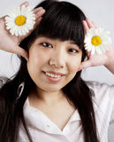Chinese girl with Russian camomiles Royalty Free Stock Photo