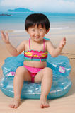Chinese girl on the sand beach. With bear and Three-point swimsuit Stock Images