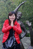 Chinese girl and sculpture stock photography