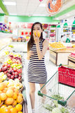 Chinese girl in the selection of fruit Stock Photography