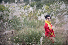 A Chinese Girl Shooting in Miscanthus Background Stock Images